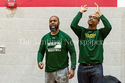 1/26/2017 - Sandy Spring Friends Head Coach Carl Parker (left) and assistant coach Jason Nwosu (right), ©2017 Jacqui South Photography