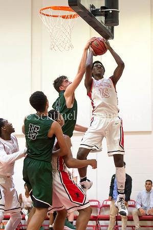 1/31/2017 - Maret's Luke Garza (55) blocks a shot attempt by St. Andrew's Anthony Duruji (15), ©2017 Jacqui South Photography
