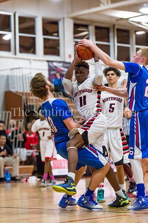 2/3/2017 - Northwood guard Burel Ngandhi (11) is called on an offensive foul as Sherwood defender Brendan Collins (10) takes the charge, ©2017 Jacqui South Photography