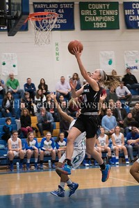 Whitman's Abbey Meyers attempts a layup for two on a breakaway.