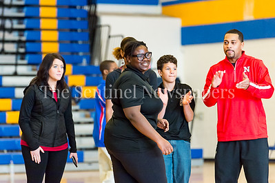 2/4/2017 - Northwood's Nadege Dogbo and her teammates are happy with her throw in the Montgomery County Bocce Championship vs Wootton High School, ©2017 Jacqui South Photography