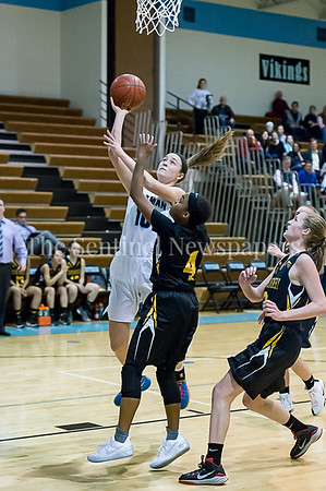 2/7/2017 - Whitman senior Abby Meyers with a layup guarded by Richard Montgomery's Karon Williams (4) , ©2017 Jacqui South Photography
