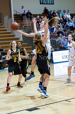 2/7/2017 - Whitman senior Abby Meyers with a layup guarded by Richard Montgomery's Melanie Osborne (12) , ©2017 Jacqui South Photography