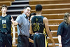 2/7/2017 - Richard Montgomery Coach Dave Breslaw meets Jashon Hawkins on the court after the 1st half, ©2017 Jacqui South Photography