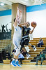2/7/2017 - Richard Montgomery guard Evan Threet (23) is fouled on a fast break by Whitman's Max Oppenheim (24), ©2017 Jacqui South Photography