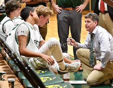Damascus Coach Buth Marshall talks with his team during a 1st period time out.