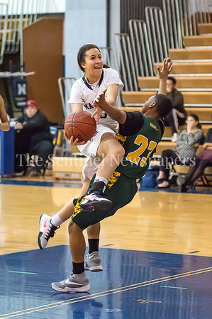 2/14/2017 - Magruder senior guard Kenz Baryoun (3) is fouled on a fast break layup by Seneca Valley's Jessica Jones (23), ©2017 Jacqui South Photography