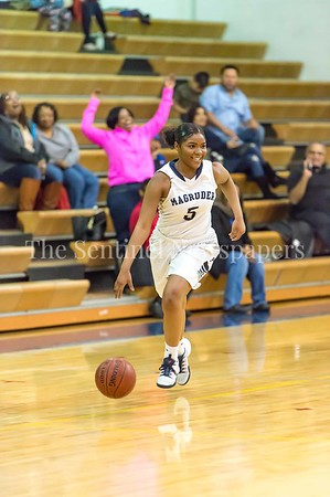 2/14/2017 -Magruder's Laila Grant (5) all smiles as she brings the ball upcourt, ©2017 Jacqui South Photography