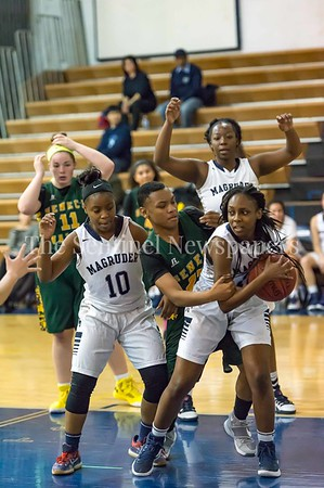 2/14/2017 - Seneca Valley's Jessica Jones (23) reaches for the ball after Magruder's Dyamond Blackman (12) grabs a defensive rebound, ©2017 Jacqui South Photography