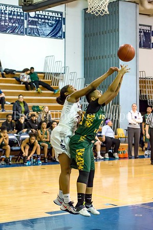 2/14/2017 - Seneca Valley guard Carman Chase (22) is fouled by Magruder defender Laila Grant (5), ©2017 Jacqui South Photography
