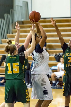 2/14/2017 - Magruder freshman Christian Smith (33) is fouled by Seneca Valley defender Lexi Opdenaker (11), ©2017 Jacqui South Photography