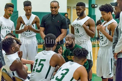 2/21/2017 - Sandy Spring Head Coach Carl Parker during a time out, ©2017 Jacqui South Photography