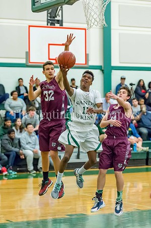 2/21/2017 - On a fast break Sandy Spring guard Malakai Parker shoots between two  St Anselm's defenders Antonio Marra (32) & Michael Gerrety (11), ©2017 Jacqui South Photography