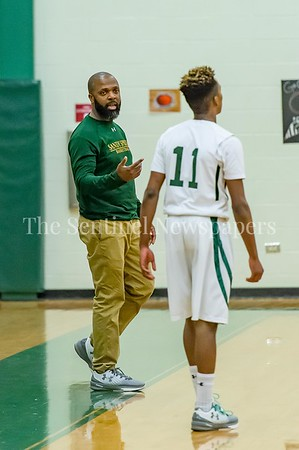 2/21/2017 - Sandy Spring Head Coach Carl Parker checks in with Malakai Parker (11) during a foul shot , ©2017 Jacqui South Photography