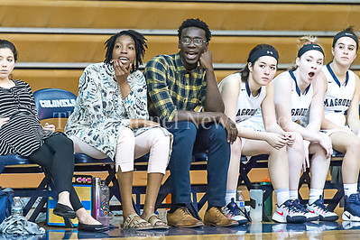 2/24/2017 - Magruder Girls Basketball Head Coach Ka'Shauna Cook (left) and Assistant Coach Tariq Uqdah (right), ©2017 Jacqui South Photography