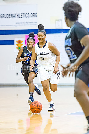 2/24/2017 - Magruder guard Laila Grant (5) brings the ball upcourt, ©2017 Jacqui South Photography