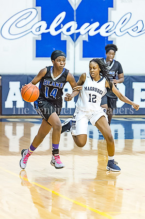 2/24/2017 - Blake guard Madina Tall (14) brings the ball upcourt guarded by Magruder defener Dyamond Blackman (12), ©2017 Jacqui South Photography