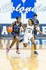 2/24/2017 - Blake guard Madina Tall (14) brings the ball upcourt guarded by Magruder defener Dyamond Blackman (12), ©2017 Jacqui South Photography