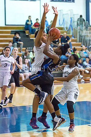2/24/2017 - Blake's Sydney Gray (21) shoots into Magruder defender Christian Smith (33), ©2017 Jacqui South Photography
