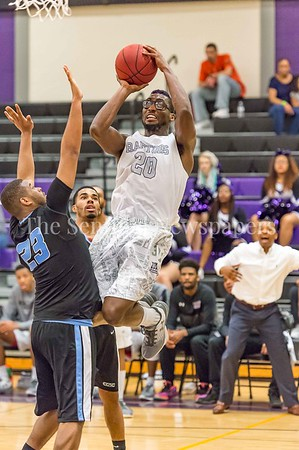 2/25/2017 - Montgomery College Patrick Smith (20) shoots over Cameron Bailey (23). Smith had a double-double with 16 points-16 rebounds, ©2017 Jacqui South Photography
