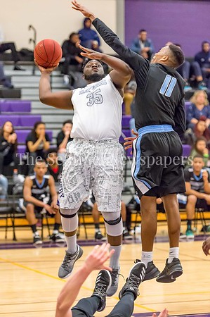 2/25/2017 - Montgomery College forward Isaac Akwara (35) shoots over Anthony Frenzley (11), ©2017 Jacqui South Photography