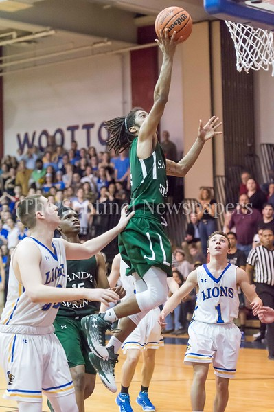 2/25/2017 - Sandy Spring Friends School guard Mike Young (4) during the PVAC Championship, ©2017 Jacqui South Photography