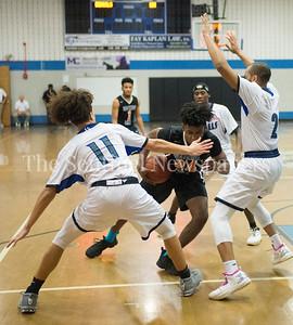 Blake High School Gabriel Wilson (11), Watkins Mill High School forward Terrance Williams jr. (24), Blake High School Kendrick Vaughn (2), 02 28 2017 Watkins Mill v Blake High Schools Boys Varsity Basketball