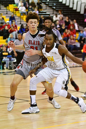 Daryn Alexander of Richard Montgomery plows past Ethan Ellisof Blair in an attempt for 2 points.