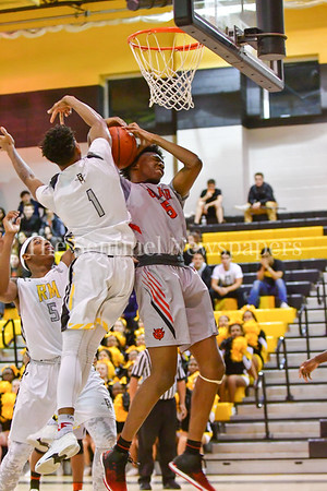 Richard Montgomery's Jordan Stover mixes it up with Blair's Julius Cobb in a fight for the rebound  under the net.  Julius maintained posession of the ball and put it back up for two.