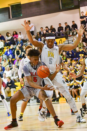 Guarded by Zaire Mitchell from Richard Montgomery HIgh School Julius Cobb bobbles the ball.