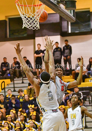 Blair's Julius Cobb gets a shot off beyond the reach of  Zaire Mitchell from Richard Montgomery High School.