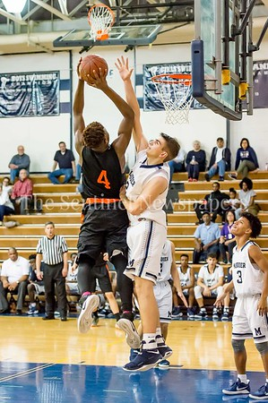 2/28/2017 - Bryan Boehlert gets a hand up in front Tyree Davis' shot, Maryland 3A South Round 2 Playoffs - Rockville v Magruder , ©2017 Jacqui South Photography