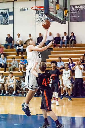 2/28/2017 - Magruder forward Bryan Boehlert (32) shoots a layup over Rockville defender Michael Mantzouranis (44),  Maryland 3A South Round 2 Playoffs - Rockville v Magruder , ©2017 Jacqui South Photography