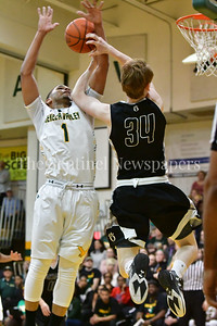 Seneca Valley's Trey Lucas blocks a shot by Oakdale's Chase French.