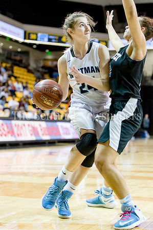 3/9/2017 - Whitman guard Elyse Lowet (24) drives on Roosevelt defender Nia Scott in the Maryland 4A Girls Semi-Final - Roosevelt v Whitman, ©2017 Jacqui South Photography