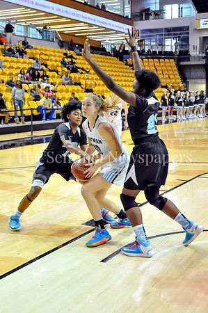 3/8/2016 - Abby Meyers (10) drives through 2 Roosevelt defenders Chioma Ezoma (21) and Octavia Wilson (13) in the Maryland 4A Girls Semi-Final - Roosevelt v Whitman, ©2017 Jacqui South Photography
