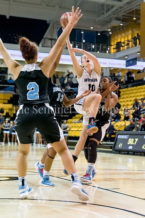 3/9/2017 - Whitman guard Abby Meyers draws the foul as she drives in the lane through three Roosevelt defenders, Nia Scott (2), Octavia Wilson (13) and Alia Parker (24) in the Maryland 4A Girls Semi-Final - Roosevelt v Whitman, ©2017 Jacqui South Photography