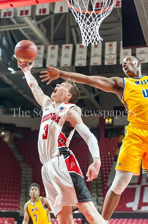 3/9/2017 - Wise defender Darron Barnes (4) looks to block a reverse layup by Quince Orchard forward Johnny Fierstein (3) in the Maryland 4A Boys Semi-Final - Quince Orchard v Wise, ©2017 Jacqui South Photography