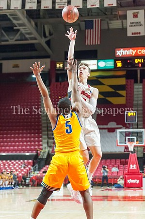 3/9/2017 - Quince Orchard's Johnny Fierstein (3) shoots over Wise defender Michael Speight (5) in the Maryland 4A Boys Semi-Final - Quince Orchard v Wise, ©2017 Jacqui South Photography