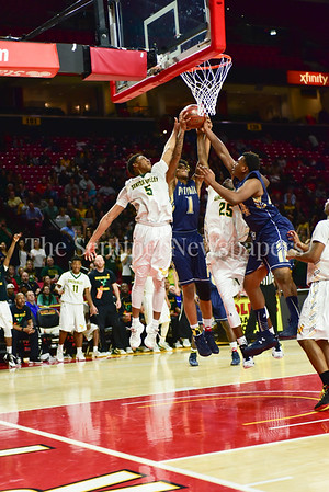03 2017 -   Late in the game, less than two minutes to go, Seneca has one of its last major battles for a rebound with Potomac. Tyran Crawford and Denard Clyburn mix it up with Potomac's Ryle Burley.   MPSSAA 3A Semi-finals.  Photo Credit:  David Wolfe