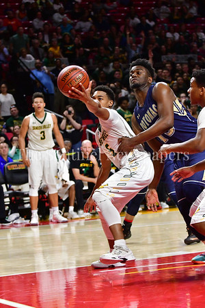 03 2017 -   Tyran Crawford holds onto a rebound while under physical pressure from Christian Dyches of Potomac.  MPSSAA 3A Semi-finals.  Photo Credit:  David Wolfe