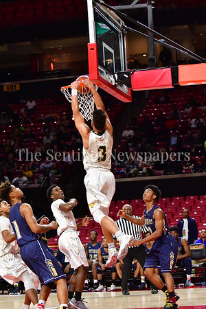 03 2017 -   Brandon Simpson on a fast break drills one through the hoop.   MPSSAA 3A Semi-finals.  Photo Credit:  David Wolfe
