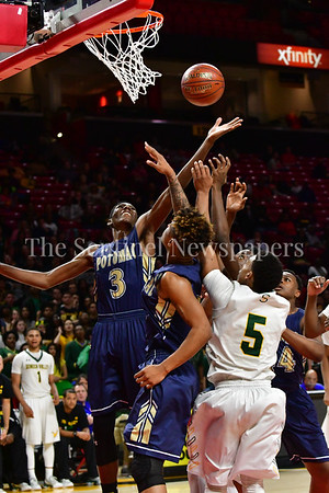 03 2017 -  The height of Travis Henson gave Potomac and advantage under the rim.  MPSSAA 3A Semi-finals.  Photo Credit:  David Wolfe