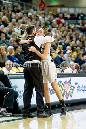 3/11/2017 - After fouling out of the game, Isabel Manzano gets a hug from Coach Peter Kenah in the Maryland Girls 4A Championship - Catonsville v Whitman, ©2017 Jacqui South Photography