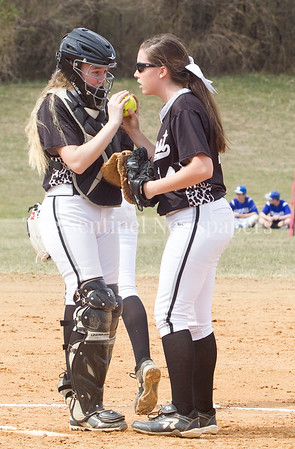 NWHS Catcher Alexa Bowen , and Pitcher Amber Yullie  chat during a time out. 03 25 2017 Northwest High School v Sherwood High School Varsity Softball. NWHS Beat SHS 9-5. First Loss for SHS in 105 games