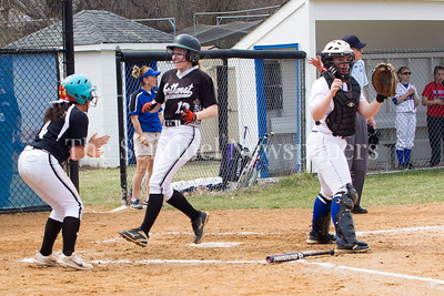 Alexa Bowen (13) crosses home plate, Emily Wiley (4) waits for her. 03 25 2017 Northwest High School v Sherwood High School Varsity Softball. NWHS Beat SHS 9-5. First Loss for SHS in 105 games