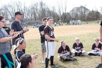 NWHS Amber Yullie (14) receives game ball as MVP. 03 25 2017 Northwest High School v Sherwood High School Varsity Softball. NWHS Beat SHS 9-5. First Loss for SHS in 105 games