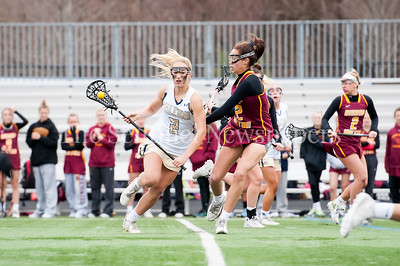 3/30/2017 - Good Counsel attack Julia Bowers (2) in the March 30, 2017 game between Bishop Ireton and Good Counsel, ©2017 Jacqui South Photography