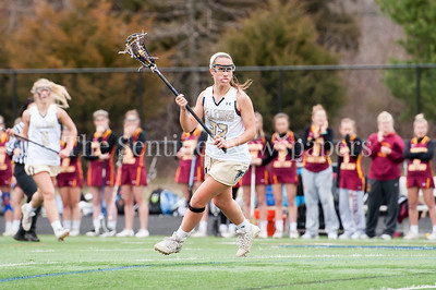 3/30/2017 - Good Counsel middie Anna Bowers (23) in the March 30, 2017 game between Bishop Ireton and Good Counsel, ©2017 Jacqui South Photography