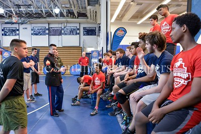 4/1/2017 - Sgt. Cameron McNeill talks with wrestlers at the USMC Sports Leadership Academy Wrestling Clinic, ©2017 Jacqui South Photography